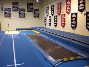 In ground tumble tramp into an in ground solid pit and an in ground foam block pit allow our athletes to gradually work their skills to the spring floor!